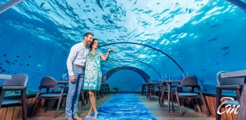 Couple At 5.8 Undersea Restaurant At Hurawalhi Maldives