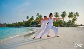 Constance Halaveli Maldives Beach yoga