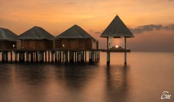 Anantara Dhigu Maldives Resort over water spa sunset