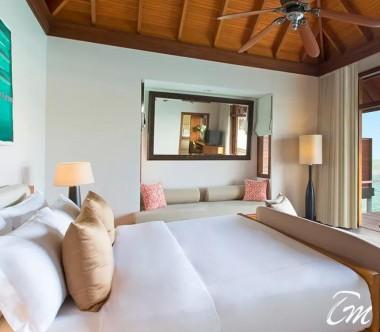 Anantara Veli Maldives Resort Deluxe Over Water Bungalow Bedroom