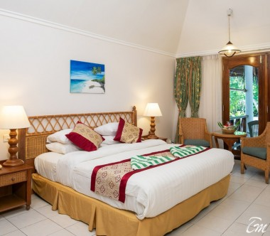 Fihalhohi Island Resort Maldives Premium Room Bed