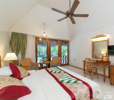 Fihalhohi Island Resort Maldives Premium Room Bedroom