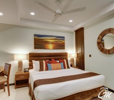 The Somerset Hotel Male Deluxe Bedroom